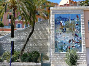 Picture of the stunning colors of French Riviera. A mosaic on a brick wall in Menton. France
