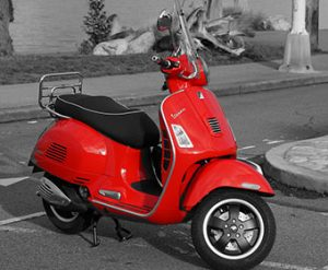 Red Vespa. The famous italian scooter by Piaggio